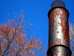 rusty metal incinerator smokestack